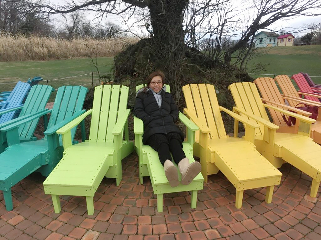 Family photo at EcoLand Jeju colourful recliner chairs