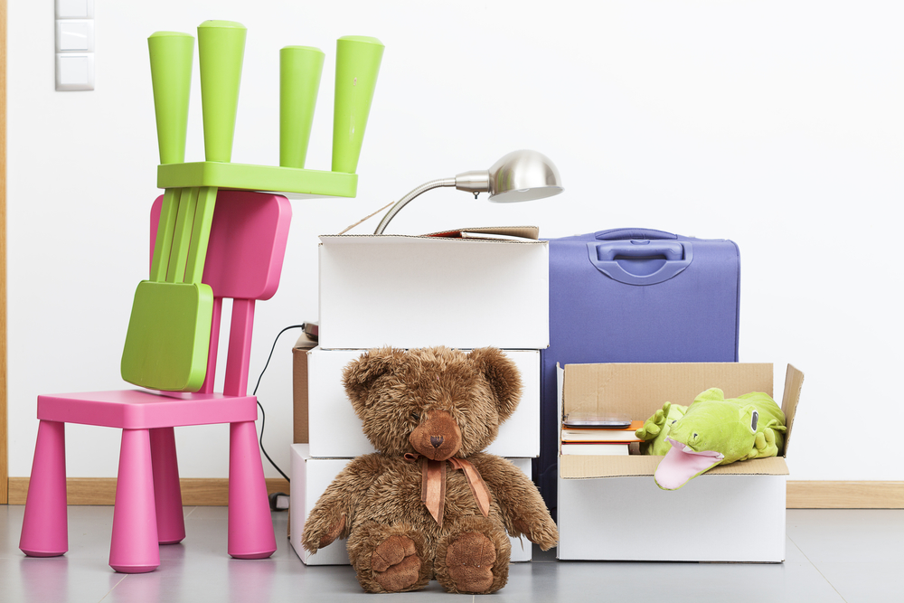used household objects, teddy bear toy, chairs and boxes