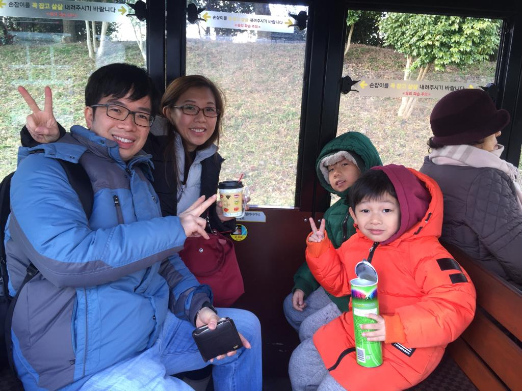 Family photo while riding in Ecoland Jeju train