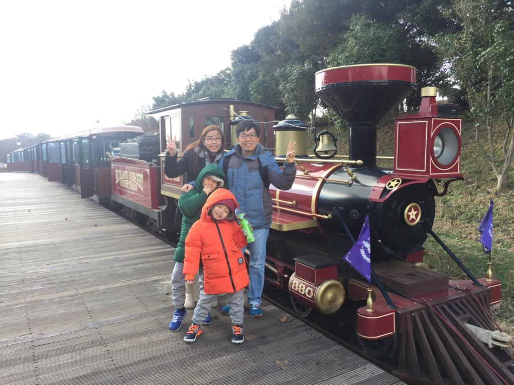 Family photo in front of Ecoland Jeju train